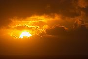 The sun sets through storm clouds developing over the Pacific Ocean in this view from Pacific Beach, Washington.