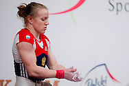 Tima Turieva from Russia lifts in Clean & Jerk competition woman's 63 kg Group A  during weightlifting IWF World Championships Wroclaw 2013 at Centennial Hall in Wroclaw on October 23, 2013.<br /> <br /> Poland, Wroclaw, October 23, 2013<br /> <br /> Picture also available in RAW (NEF) or TIFF format on special request.<br /> <br /> For editorial use only. Any commercial or promotional use requires permission.<br /> <br /> Mandatory credit:<br /> Photo by © Adam Nurkiewicz / Mediasport