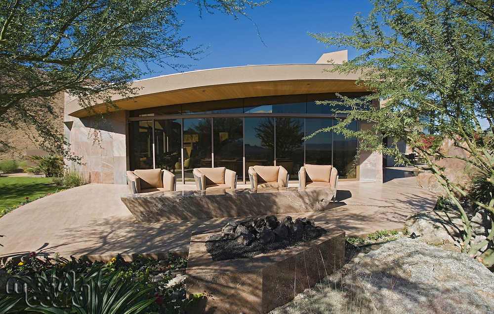 Exterior with large windows and patio furniture