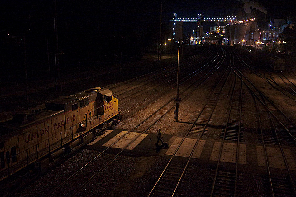 A new crew member walks across the tracks to hop aboard his loaded coal train bound for Chicago. This scene is repeated many times here, at all hours, at this busy Union Pacific yard in Clinton, IA.