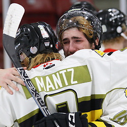 TRENTON, ON  - MAY 5,  2017: Canadian Junior Hockey League, Central Canadian Jr. &quot;A&quot; Championship. The Dudley Hewitt Cup Game 7 between Georgetown Raiders and the Powassan Voodoos.    Gary Mantz #9 and  Tyler Gervais-Rolfe #10 of the Powassan Voodoos hug post game.<br /> (Photo by Alex D'Addese / OJHL Images)