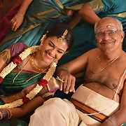 A Tamil Brahmin wedding shot by Chennai's best Wedding Photographer Rupesh Aravind from Nimitham Wedding Photography. Rupesh is one of the Top Candid Wedding photographers in Chennai who specializes in wedding portraits, pre wedding shoots, post wedding shoots and couple's photography. Rupesh is one of the most trusted and sought after Candid Wedding Photographers in Chennai.