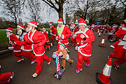 The start - The London Santa Run 2015 in Battersea Park - 2,000 Santa's take part in an annual 'Red & White' bearded 'charge' around Battersea Park in a 6k festive charity fun run. The runners are of all ages and abilities and many run at a very slow pace but enjoy the event and the cause. The Santa Run is organised to raise funds for Disability Snowsport UK, a national charity helping people with disabilities to access the thrill of snowsports. The charity ensures that children and adults, with a range of disabilities (including cerebral palsy, Down's syndrome,  visual impairment and autism), can access programs across the UK to enable them to make friends, improve their confidence and have fun through a sport which they would otherwise be excluded from.