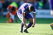Disappointed  Anton Walkes of Portsmouth punches the pitch in frustration at full time during the EFL Sky Bet League 1 match between Blackpool and Portsmouth at Bloomfield Road, Blackpool, England on 31 August 2019.