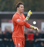 Lincoln City goalkeeper Paul Farman organises his defence during the The FA Cup match between Whitehawk FC and Lincoln City at the Enclosed Ground, Whitehawk, United Kingdom on 8 November 2015. Photo by Bennett Dean.