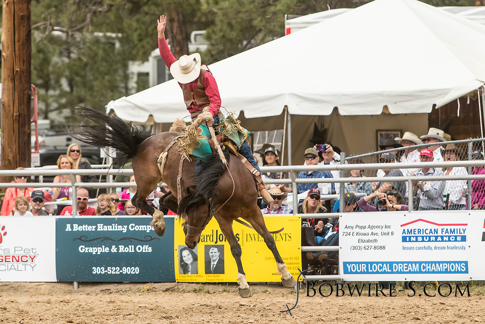 Saddle brond rider Tyler Turco rides Summit Pro Rodeo's First City during the third performance of the Elizabeth Stampede on Sunday, June 3, 2018.