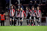 Brentford striker, Scott Hogan (9) celebrating scoring 1-0 during the Sky Bet Championship match between Brentford and Cardiff City at Griffin Park, London, England on 19 April 2016. Photo by Matthew Redman.