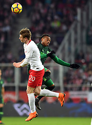 WROCLAW, March 24, 2018  Lukasz Piszczek (L) of Poland vies with Joel Obi of Nigeria during an international friendly game between Poland and Nigeria in Wroclaw, Poland, on March 23, 2018. Nigeria won 1-0. (Credit Image: © Jaap Arriens/Xinhua via ZUMA Wire)
