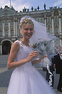 A bride celebrating her marriage in Palace Square<br /> in front of the Hermitage<br /> St. Petersburg, Russia