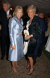 Left to right, LADY HINDLIP and MRS BLUEY MAVROLEON at the annual Chelsea Flower Show dinner hosted by jewellers Cartier at the Chelsea Pysic Garden, London on 22nd May 2006.<br />
