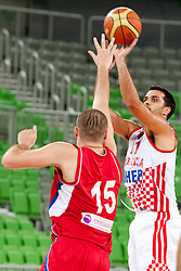 Milan Macvan of Serbia and Krunoslav Simon of Croatia during friendly basketball match between National teams of Croatia and Serbia of Adecco Ex-Yu Cup 2012 as part of exhibition games 2012, on August 3rd, 2012, in Arena Stozice, Ljubljana, Slovenia. (Photo by Urban Urbanc / Sportida)
