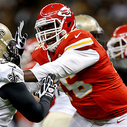 Aug 9, 2013; New Orleans, LA, USA; Kansas City Chiefs tackle Branden Albert (76) works against New Orleans Saints linebacker Will Smith (91) during a preseason game at the Mercedes-Benz Superdome. The Saints defeated the Chiefs 17-13. Mandatory Credit: Derick E. Hingle-USA TODAY Sports