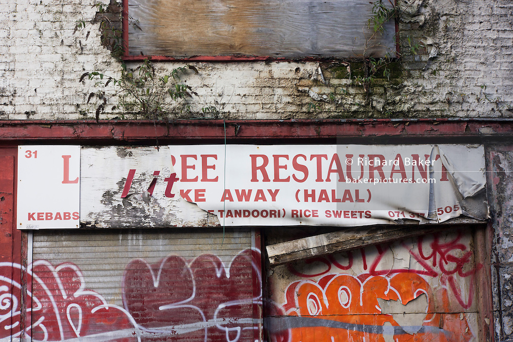 Derelict Halal restaurant businesses left to decay on Toynbee Street, Tower Hamlets, East London.