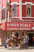 Cowboys parade past the Wrangler western wear store during the Cheyenne Frontier Days parade through the state capital July 23, 2015 in Cheyenne, Wyoming. Frontier Days celebrates the cowboy traditions of the west with a rodeo, parade and fair.