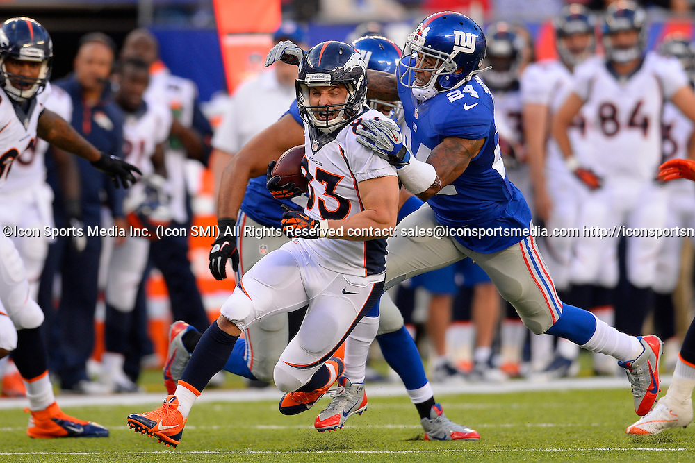 September 15, 2013: New York Giants defensive back Terrell Thomas (24) tackles Denver Broncos wide receiver Wes Welker (83) during a week 2 NFL matchup between the Denver Broncos and the New York Giants at MetLife Stadium is East Rutherford NJ. The Broncos defeated the Giants 41-23.