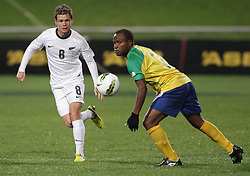 New Zealand's Michael McGlinchey chases the ball with Solomon Islands' Nelson Sale Kilifa in a FIFA World Cup Qualifier Match, North Harbour Stadium, Auckland, New Zealand, Tuesday, September 11, 2012.  Credit:SNPA / David Rowland