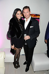 Left to right, Nick Candy, Duangpatra Bodiratnangkura at a party to launch the Autumn/Winter 2013 Candy Magazine held at The Saatchi Gallery, Duke of York's HQ, King's Road, London on 15th October 2013.