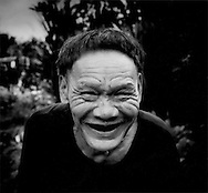 Unbridled mirth: Paren, the oldest man in the Penan settlement of Long Kelamu, several hours walk into the Borneo forest from Long Lellang, Sarawak, Malaysia.