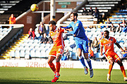 Peterborough Utd defender Ryan Tafazolli (5) clears this ball into the box ahead of Shrewsbury Town forward Aaron Holloway (20) during the EFL Sky Bet League 1 match between Peterborough United and Shrewsbury Town at London Road, Peterborough, England on 23 February 2019.