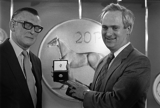 First 20p Coin..1986..29.10.1986..10.29.1986..29th October 1986..At the Central Bank's Currency Centre and Mint the Minister for Finance,Mr John Bruton,was on hand for the issue of the new 20p coin..Initially 20 million new 20p coins will be put into circulation...To commemorate the issue of the new 20p coin,The Minister for Finance,Mr John Bruton TD is presented with the first 20p coin minted.The presentation was carried out by Tomás F. Ó Cofaigh,Governor of The Central Ban