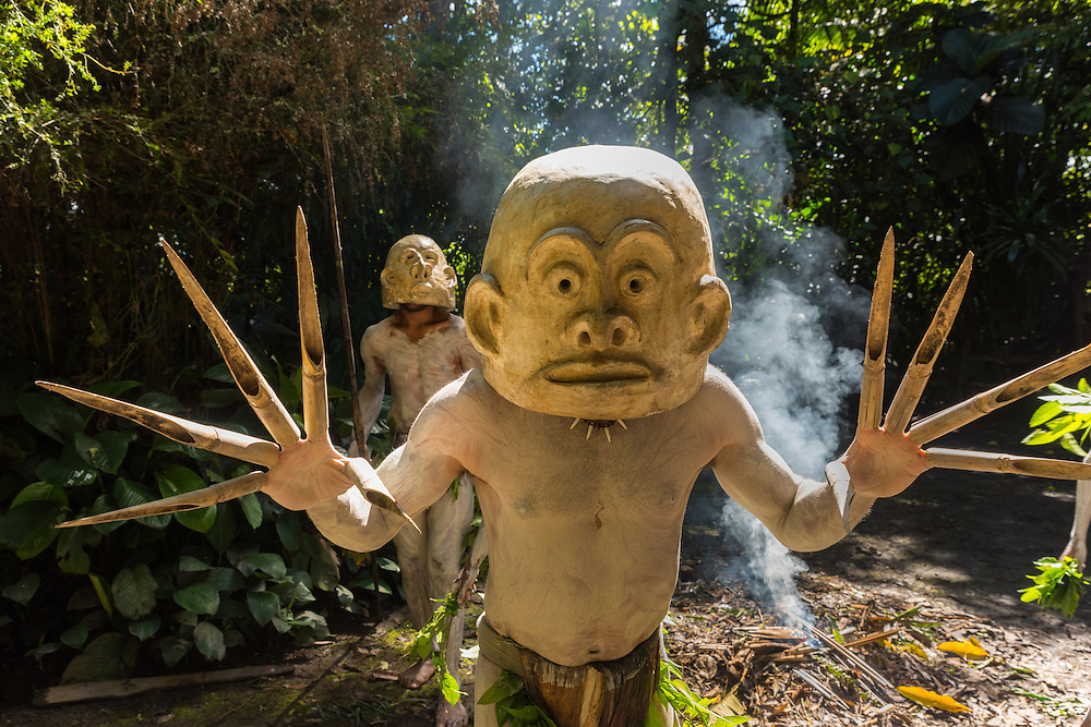 Asaro mudmen showing his hands and mask, Western Highlands, PNG.
