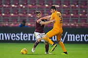 Benjamin Garuccio (#17) of Heart of Midlothian and Declan Gallagher (#31) of Livingston FC fight for the ball during the 4th round of the William Hill Scottish Cup match between Heart of Midlothian and Livingston at Tynecastle Stadium, Edinburgh, Scotland on 20 January 2019.