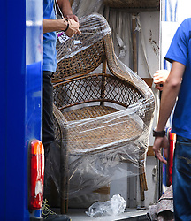 "© Licensed to London News Pictures. 16/07/2016. London, UK. A wicker chair marked for ""BED 1 TOP FLOOR""  being placed in a van for David Cameron. Removal men begin to take items from numbers 10 and 11 at Downing Street at the end of the week that saw Prime Minister David Cameron leave and Theresa May arrive. Photo credit: Ben Cawthra/LNP"