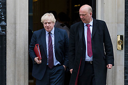 © Licensed to London News Pictures. 13/03/2018. London, UK. Foreign Secretary Boris Johnson (L) and Transport Secretary Chris Grayling (R) leave 10 Downing Street after a meeting of the Cabinet. Photo credit: Rob Pinney/LNP