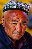A Uyghur man at the weekly market at Opal (Upal), a village along the Karokoram Highway (50 km. southwest of Kashgar) which follows the old Silk Road route from China to Pakistan, Xinjiang Province, China. Uyghur people are a Central Asian people of Muslim Turkic origin.