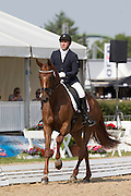Anthony Astier - Della Scala<br /> FEI World Breeding Dressage Championships for Young Horses 2012<br /> © DigiShots