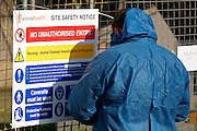 Redgrave, Suffolk. 23,000 poultry are set to be culled at Bridge Farm near Redgrave in Suffolk, after a suspected bird flu outbreak on the poultry farm. Pictured is a Animal Health Officer from the Animal and Plant Health Agency putting up signs at the affected site. <br /> <br /> Picture: MARK BULLIMORE