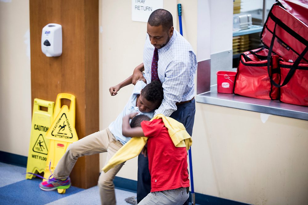 Eric Bethel, principal at Turner Elementary School in Washington, D.C., breaks up a scuffle between good friends during lunch period on May 4, 2017.