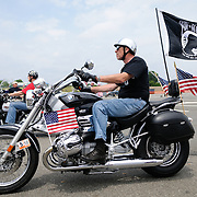A rider with a POW-MIA (Prisoner of War - Missing in Action) flag participating in the annual Rolling Thunder motorcycle rally through downtown Washington DC on May 29, 2011. This shot was taken as the riders were leaving the staging area in the Pentagon's north parking lot, where thousands of bikes and riders had gathered.
