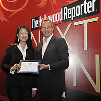 HONG KONG - MARCH 24:  Hollywood Reporter's Senior VP, Publishing Director Eric Mika (R) and Alvina Wong during The Hollywood Reporter Next Gen Asia Launch Cocktail Reception event at the W Hotel Kowloon on March 24, 2009 in Hong Kong. The initiative has recognised over 500 individuals under 35 over the last 15 years, and is run in conjunction with the Hong Kong International Film Festival.  Photo by Victor Fraile / studioEAST