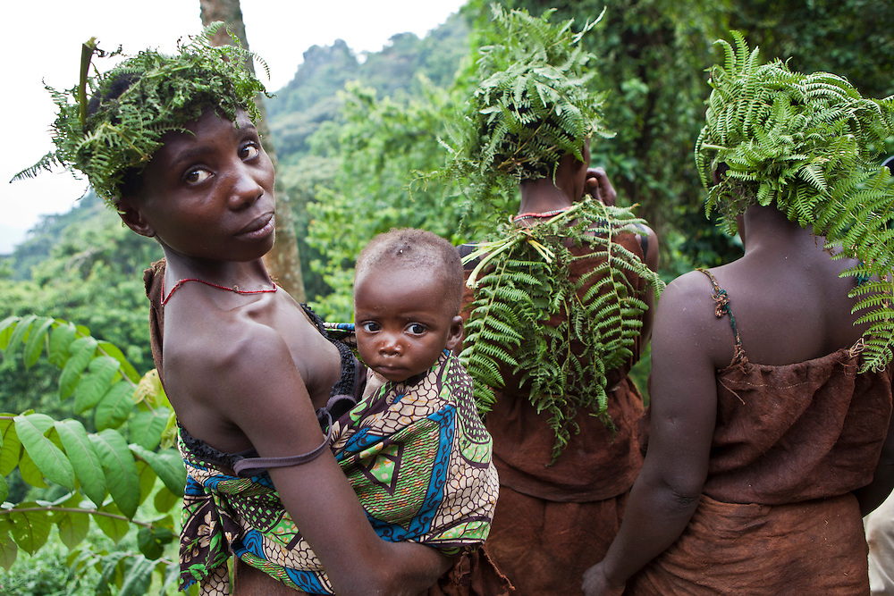 The people of Mukuno village who are traditional Batwa tribes people  from the Bwindi Impenetrable Forest in Uganda. They were indigenous forest nomads before they were evicted from Bwindi Impenetrable Forest in 1992 when it was made a World Heritage site to protect the mountain gorillas. With the help of the Batwa Development Program they have re-created a village in the forest on land they now own.