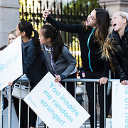 NYTRUN - NOV. 6, 2016 - NEW YORK - Emma Sobel, second from right, and Reed Huneke, right, snap a selfie as they wait for runners in front of the Cooper Hewitt Museum on 5th Avenue, just north of E 90th Street. They were there to cheer on participants of the 2016 TCS New York City Marathon on Sunday. NYTCREDIT:  Karsten Moran for The New York Times **PLS CHECK FINISH PLACE AND TIMES