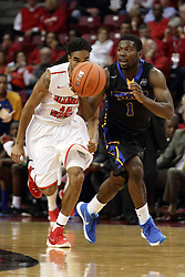 16 November 2015: Tony Wills(12) looks to steal the ball from Malik Maitland. Illinois State Redbirds host the Morehead State Eagles at Redbird Arena in Normal Illinois (Photo by Alan Look)