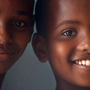 Houmed, 13, left, and Said Abdoul, 11, wait for their skit in a classroom as part of World Environmental Day. Students from five local elementary schools came to Ecole Annexe 1 in Djibouti City for World Environment Day. The children performed skits on environmental awareness and speakers included Elmi Obsieh Waiss, Djiboutian Minister of Environmental Management and City Planning and Sunil Saigal, Resident Coordinator of the United Nations Operational Activities for Development and Resident Representative of United Nations Development Program. <br />