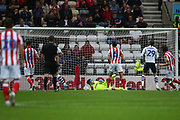 The ball goes under the body of Stoke City goalkeeper Jack Butland (1) as Preston North End midfielder Billy Bodin (39) scores a goal 2-0 during the EFL Sky Bet Championship match between Preston North End and Stoke City at Deepdale, Preston, England on 21 August 2019.