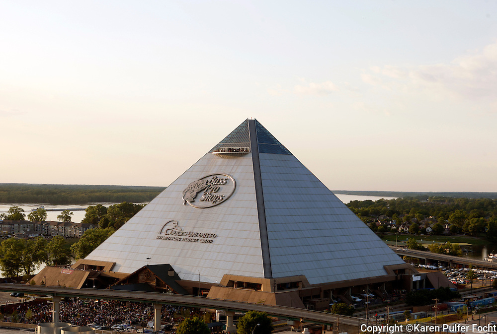 Crowds gather outside the Pyramid during the grand opening of Bass Pro Shop Wednesday night. The new Bass Pro Shops is set next to the Mississippi River in Memphis, Tenn. The megastore, which opened April 29.  It is built inside a Pyramid built originally as an arena.  The building is about 535,000-square foot and now is home to a hotel, restaurants, observation deck, mega store, shooting range and bowling alley.
