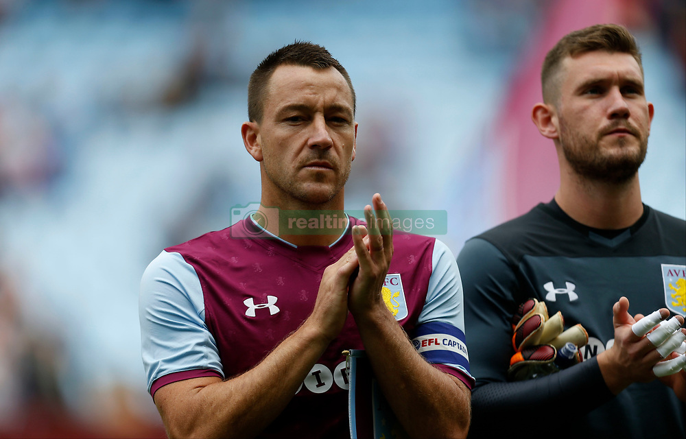 Aston Villa's John Terry during a minutes applause before the Graham Taylor tribute match at Villa Park, Birmingham.