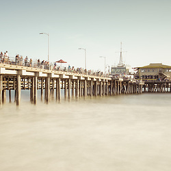 Santa Monica Pier retro panorama photo. Santa Monica is a coastal beach city along the Pacific Ocean in Los Angeles County California. Panoramic photo ratio is 1:3. Copyright ⓒ 2017 Paul Velgos with All Rights Reserved.