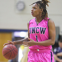 UNCW's Naqaiyyah Teague drives against Northeastern Sunday February 15, 2015 at Trask Coliseum. (Jason A. Frizzelle)