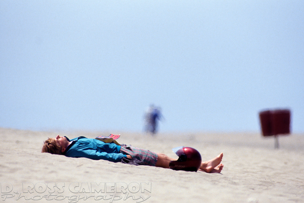 Unidentified sunbather takes in the rays on San Francisco's Ocean Beach, Saturday, May 23, 1992. (Photo by D. Ross Cameron)