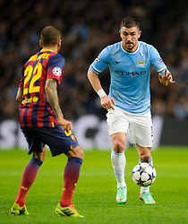 Man City Forward Edin Dzeko (BIH) runs at Barcelona Defender Daniel Alves (BRA) - Photo mandatory by-line: Rogan Thomson/JMP - Tel: 07966 386802 - 18/02/2014 - SPORT - FOOTBALL - Etihad Stadium, Manchester - Manchester City v Barcelona - UEFA Champions League, Round of 16, First leg.