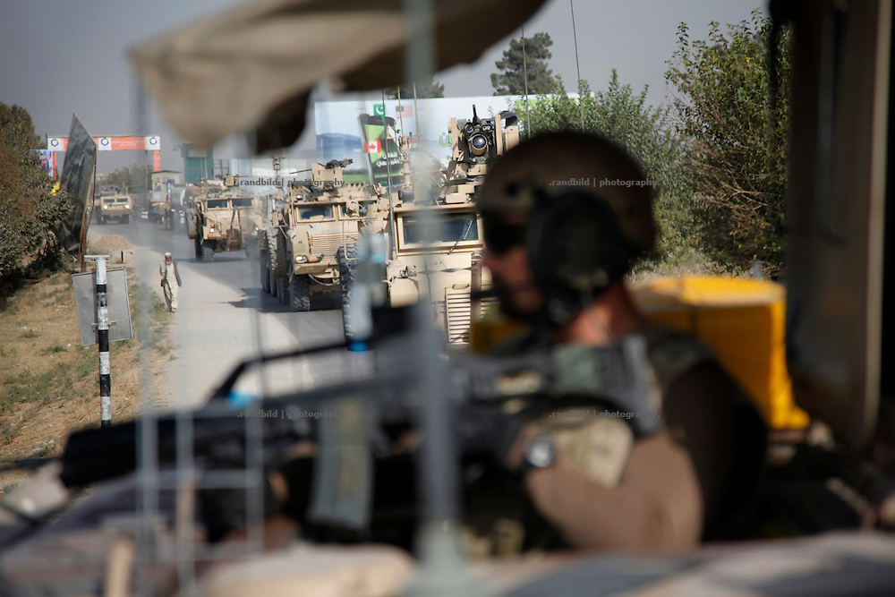 A german pioneer platoon rides out PRT Kunduz on a re-supply mission to the District Headquaters in Chahar Dareh.