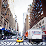 Yellow Cab driving fast in Manhattan street