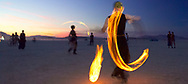 BLACK ROCK CITY, NV:  Fire dancers at dusk on the playa in Black Rock City, Nevada.