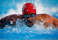 Xavier Mascareñas/Treasure Coast Newspapers; Luis Moreno of South Fork High School keeps the lead to take first, while setting a new personal record, in the boys 100 yard butterfly at the Class 3A District 10 swimming championships at Sailfish Splash Park in Stuart on Wednesday, Oct. 22, 2014.