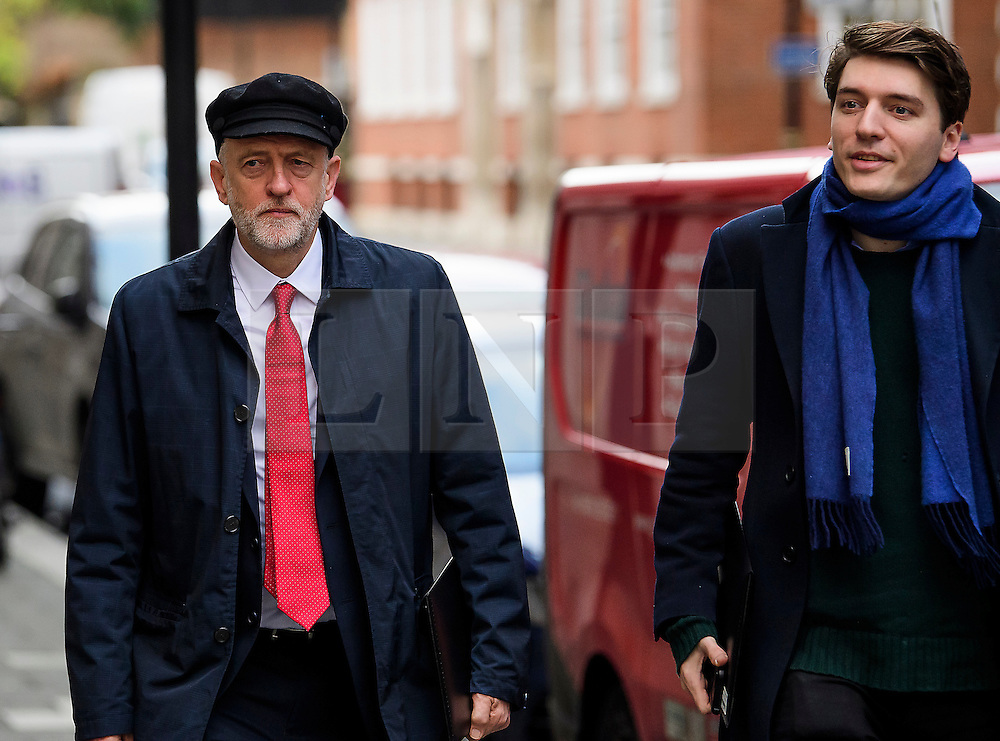 """© Licensed to London News Pictures. 10/01/2017. London, UK. Labour Party leader JEREMY CORBYN (left) seen in London with JAMES SCHNEIDER of Momentum (right) , on the day he is due to give a speech on Brexit, arguing that the UK """"can be better off"""" after leaving the EU. Photo credit: Ben Cawthra/LNP"""